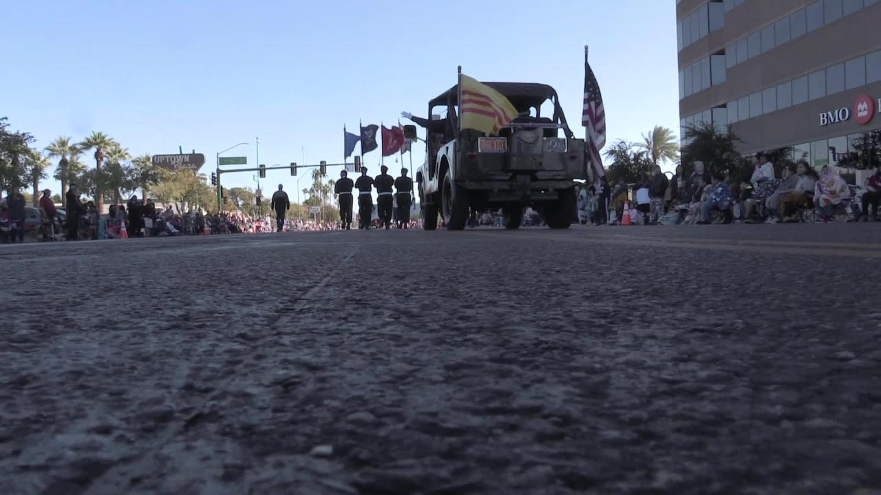 A crowd cheers for military service members during the Veterans Day Parade in Phoenix on Nov. 12, 2018.