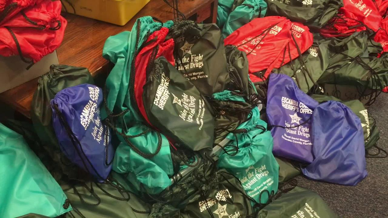 Students at N.B. Cook Elementary carried in boxes upon boxes of drawstring backpacks stuffed with homework supplies for Oakcrest Elementary students.