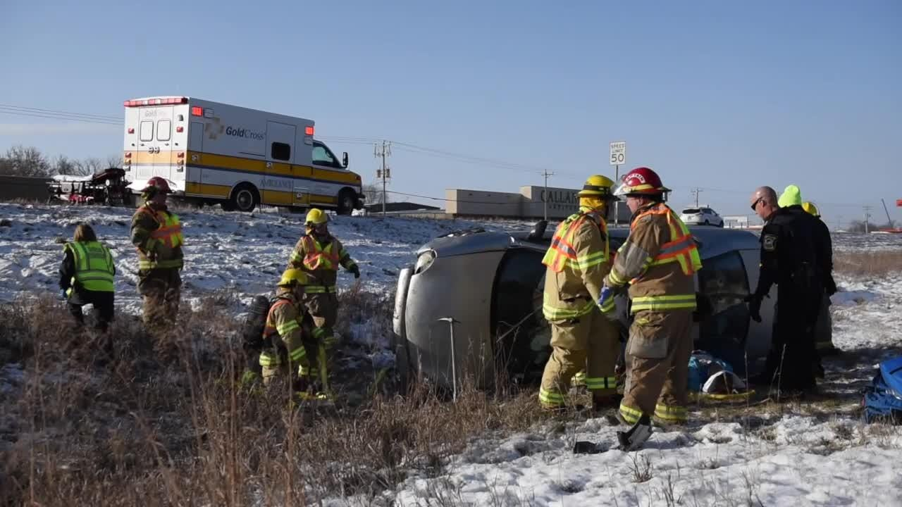 Waite Park Firefighters work to free the trapped driver after a one car rollover Tuesday, Nov. 13, near Fleet Farm in Waite Park. The driver was taken to the St. Cloud Hospital by Gold Cross Ambulance.