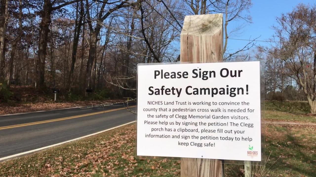NICHES Land Trust has started a signature campaign for a flashing crosswalk to assist visitors to the trail at Clegg Memorial Garden.