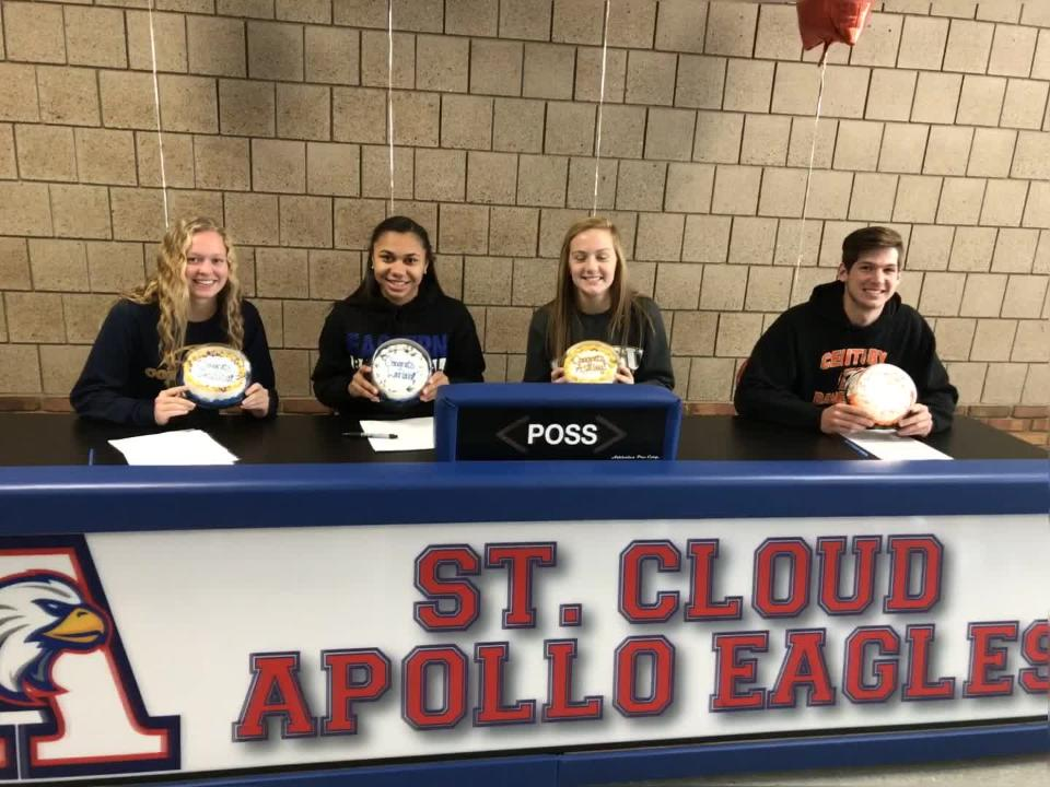 St. Cloud Apollo seniors Jessica Timpane (Concordia-St. Paul women's soccer), Lariah Washington (Eastern Illinois women's basketball), Ashley Koepp (Southwest Minnesota State women's soccer) and John Huebsch (Century College baseball) show off signing ceremony cakes Wednesday at Apollo.
