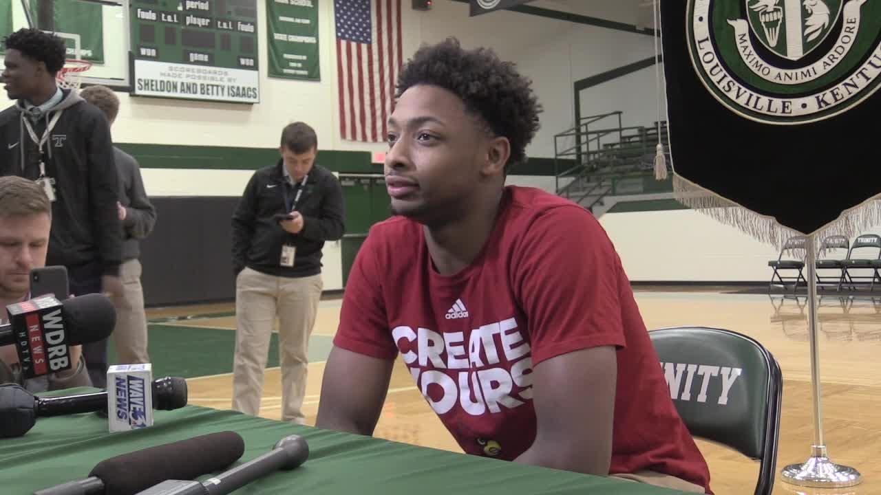Trinity's David Johnson signs to Louisville basketball
