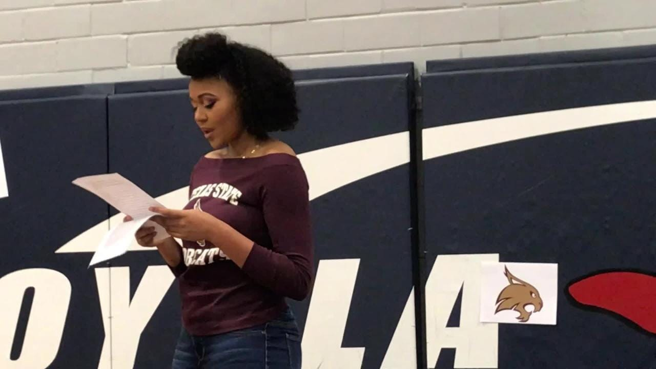 Loyola's Chelsea Johnson gives thanks at her signing event.