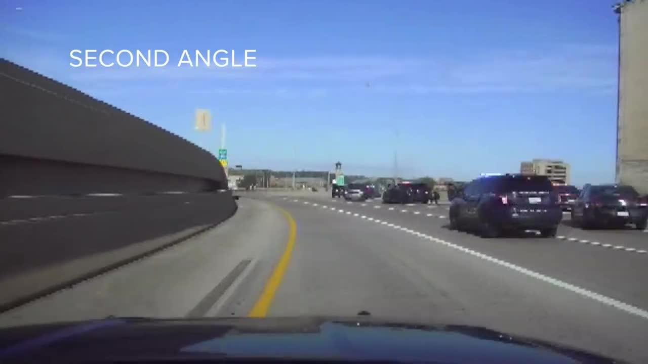 Police released the dash cam video Wednesday showing a Grand Rapids police cruiser take down a murder suspect on U.S. 131.