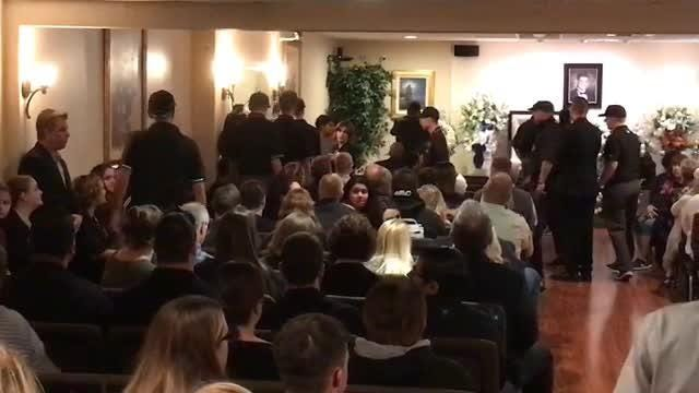 Pastor James O'Connell conducts the Nov. 14, 2018, service for Cody Gifford-Coffman, who was killed in the Borderline shooting in Thousand Oaks.
