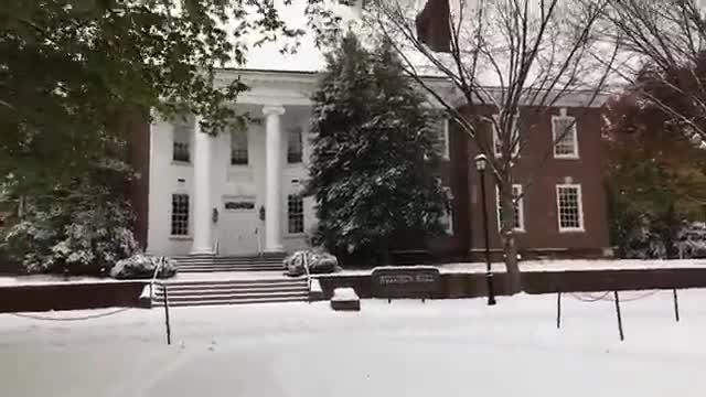 Reporter Josephine Peterson walks through The Green at UD during the height of Thursday's snow storm.