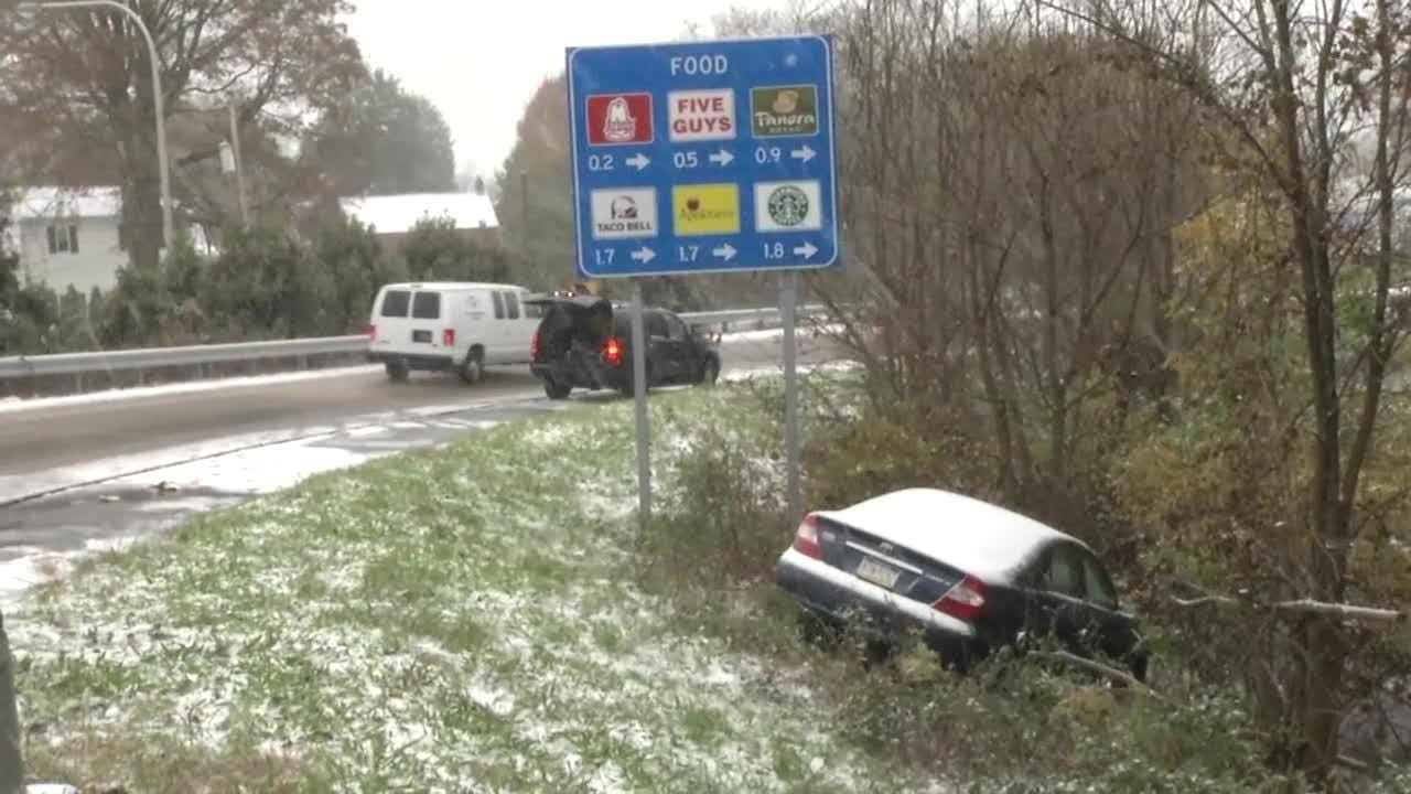 A tractor trailer snapped a utility pole on Philadelphia Pike in Claymont, and a car slides off the Del. 141 offramp in Price Corner as the storm moves through.