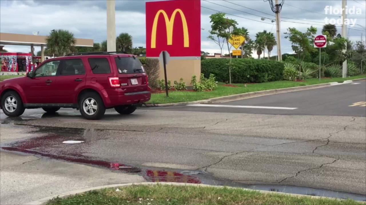 Melbourne police charged a man with aggravated assault after a McDonald's employee was told she would get shot