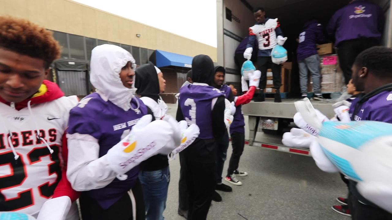 New Rochelle and White Plains high school football players unload 1,000 Stop & Shop turkeys from a truck at Feeding Westchester Thursday,  Nov. 15, 2018.