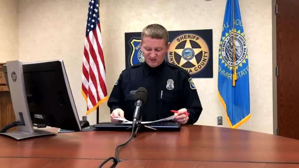 Police spokesman Sam Clemens goes over the call log during Friday's police briefing.