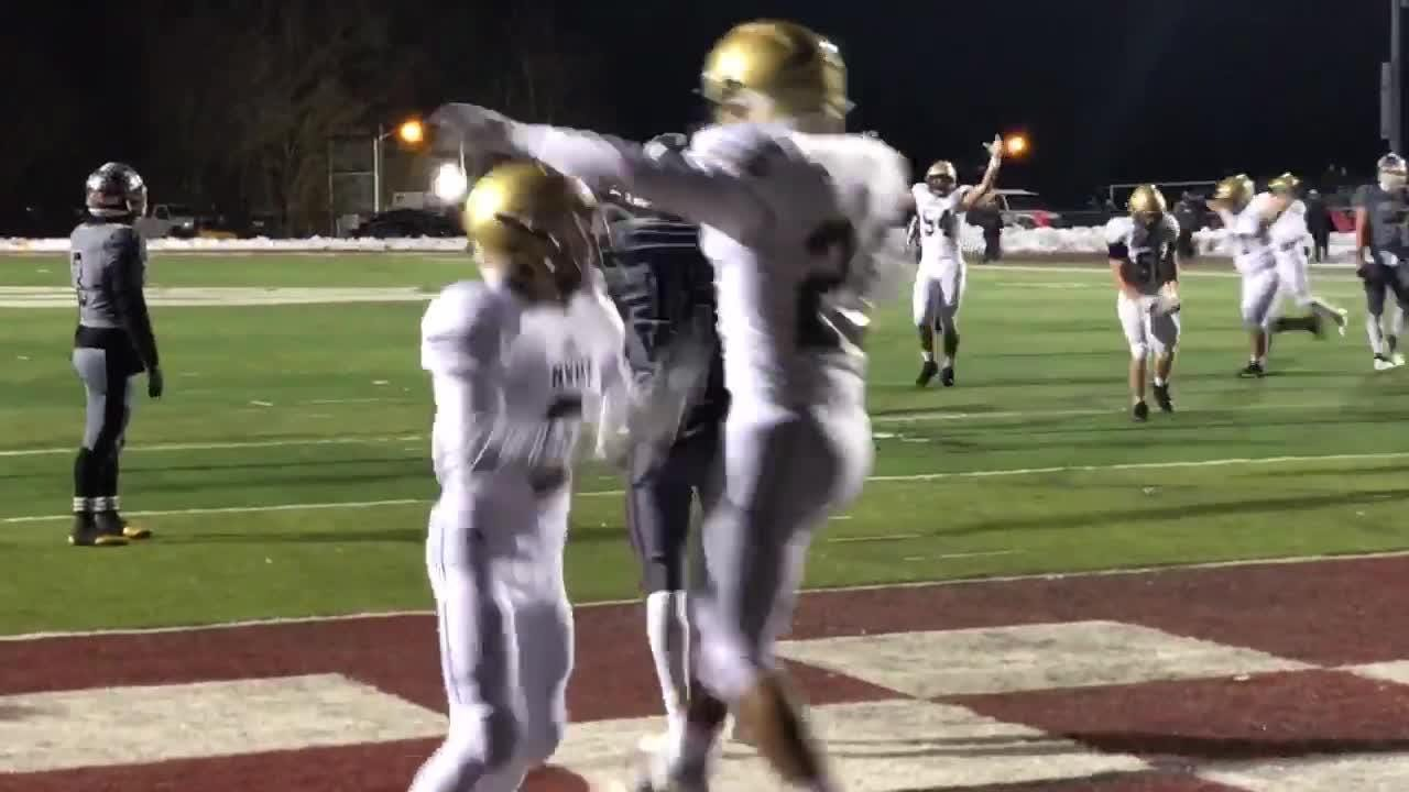 Andrew Dippolito throw a 14-yard TD pass to Mike Spilotras to put NV/Old Tappan ahead 13-0.