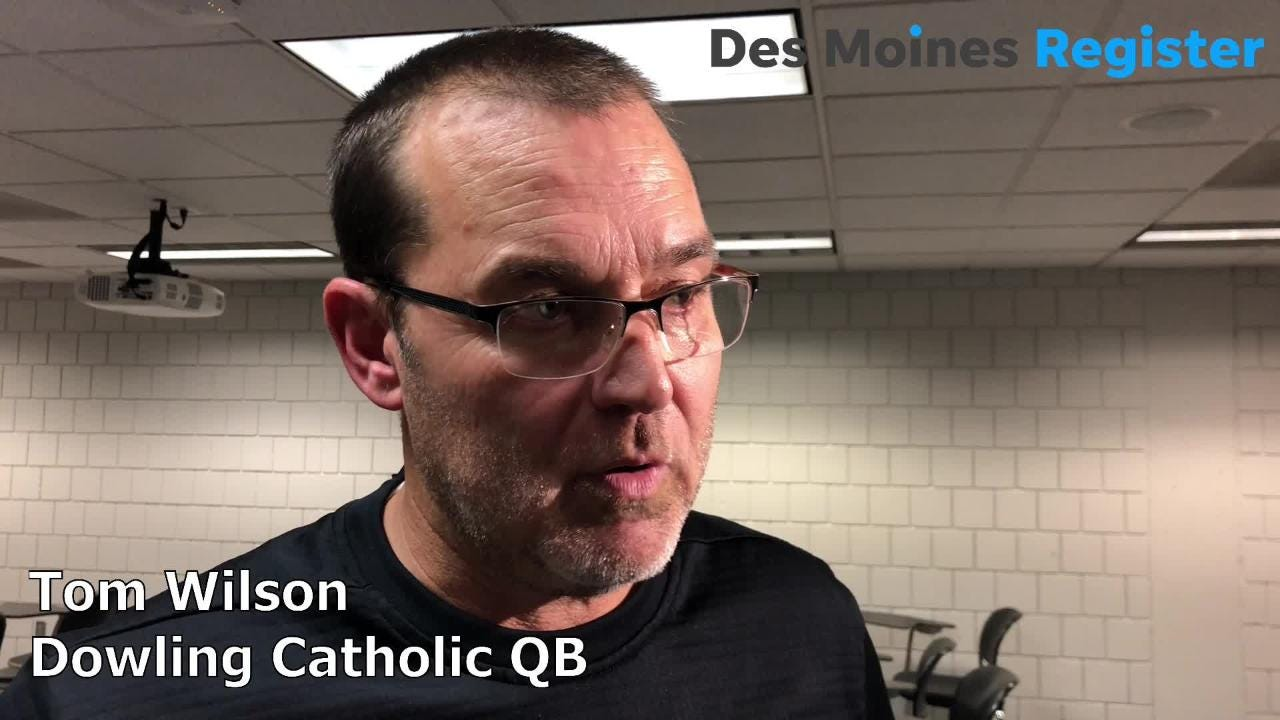 Tom Wilson, Dowling's head football coach, reacts after the Maroons beat Cedar Falls, 22-16, to win the Class 4A state title on Friday night.