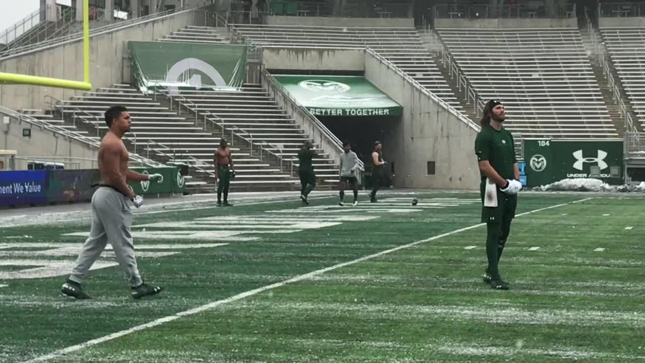 CSU running back Izzy Matthews, from California no less, was one of several players warming up shirtless in the snow before the Rams play Utah State.