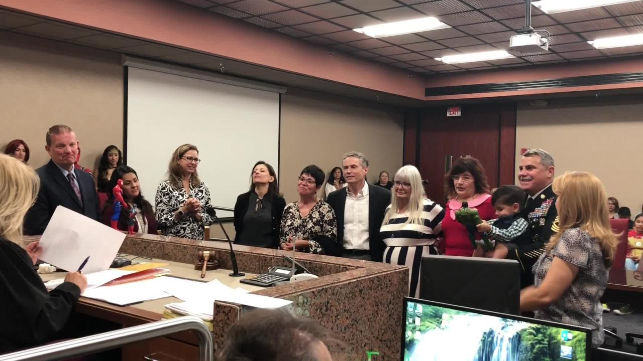 Ayden Lopez-Puig is officially adopted by his foster parents, David Puig and Linda Lopez-Puig, on Saturday at the El Paso County Courthouse.