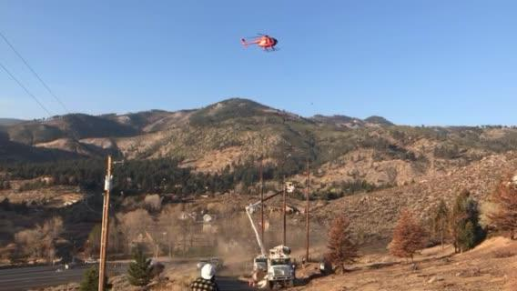 An NV Energy helicopter helps crews replace I-580 power lines on Nov. 17