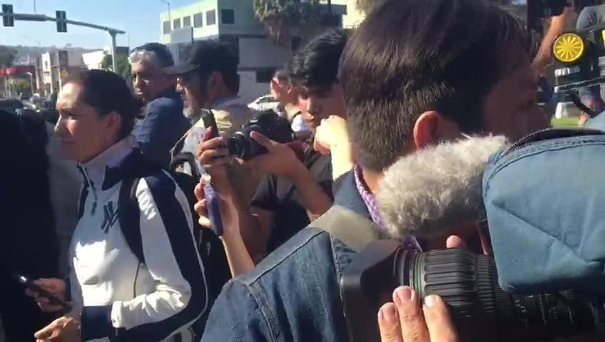 Tijuana residents marched in the streets, some in support of the Central American migrant caravan, some opposed to their presence in Tijuana.