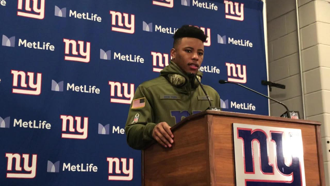 NY Giants rookie Saquon Barkley talks to reporters after Sunday's 38-35 victory over the Buccaneers at MetLife Stadium.