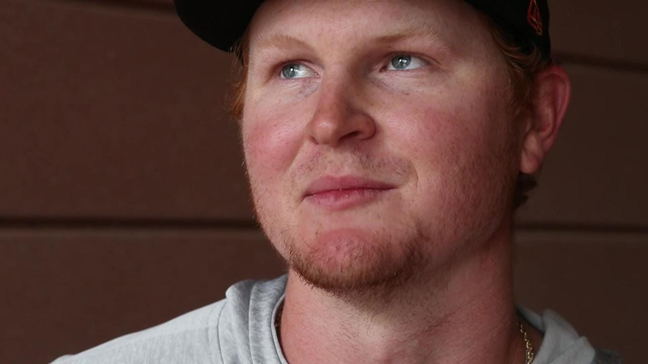 Pavin Smith talks about paying off his parents' mortgage on Nov. 14 at Salt River Fields.