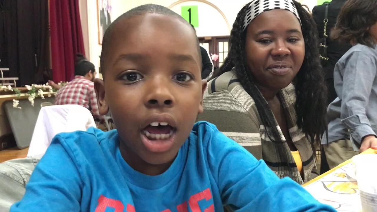 Tyler Bryant, a 6-year-old Morse Elementary School student, gives thanks.