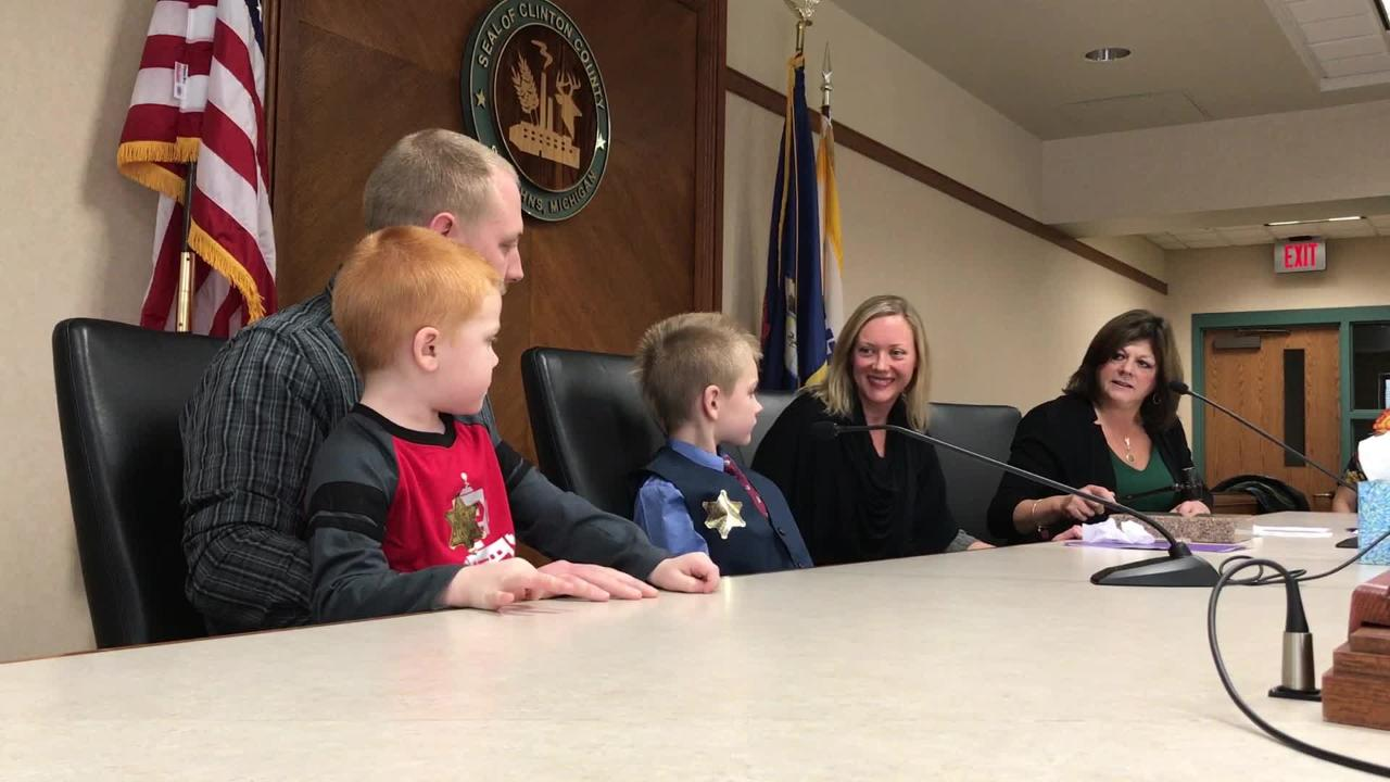 Seven-year-old Grayson Wilder finalizes his adoption with the hammering of a gavel during a ceremony at the Clinton County Courthouse in St. Johns.