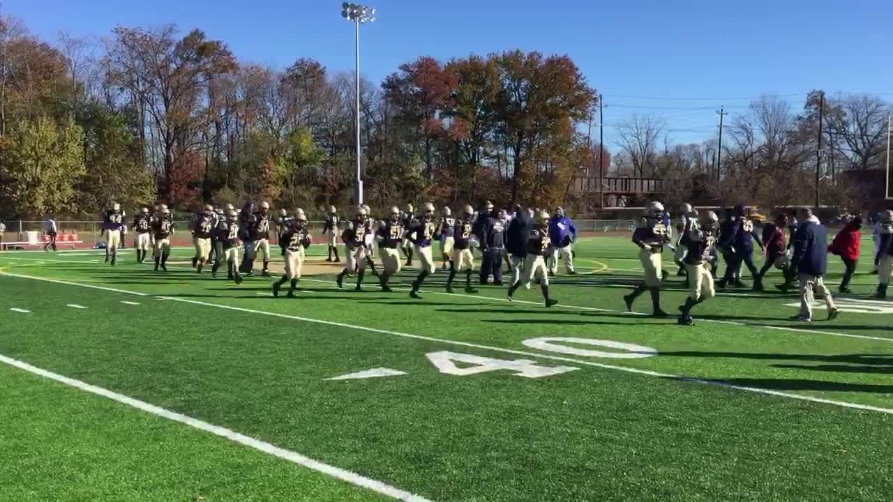 The Hackensack and Teaneck football teams shook hands before their Thanksgiving Day rivalry game