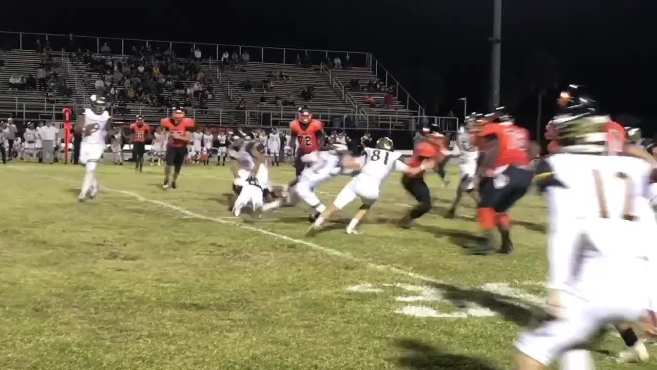 Cocoa Tigers football team defeats  Bishop Verot 38-14 to win the Class 4A, Region 4 title.