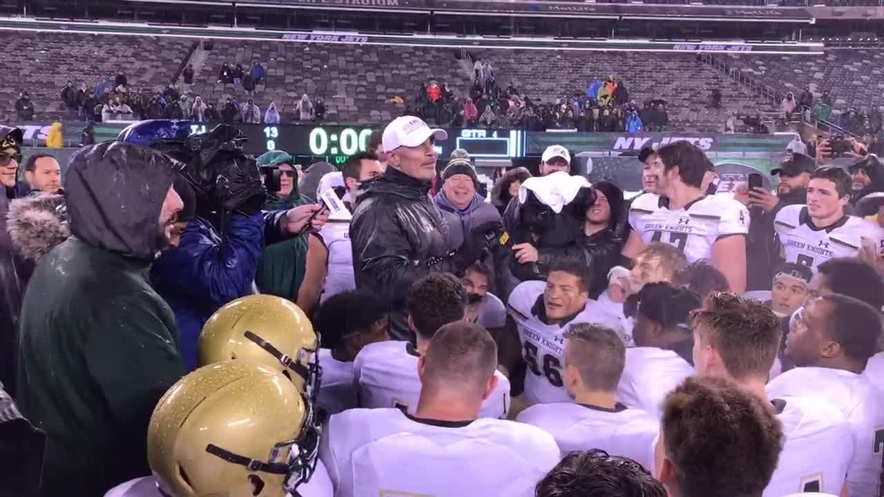 St. Joseph coach Augie Hoffmann addresses his team after winning the Non-Public 4 championship at MetLife Stadium.