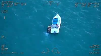 A pair of stranded jet skiers were rescued at the Sebastian Inlet by a passing boater. The incident was captured on video by a Sheriff's Office helicopter.
