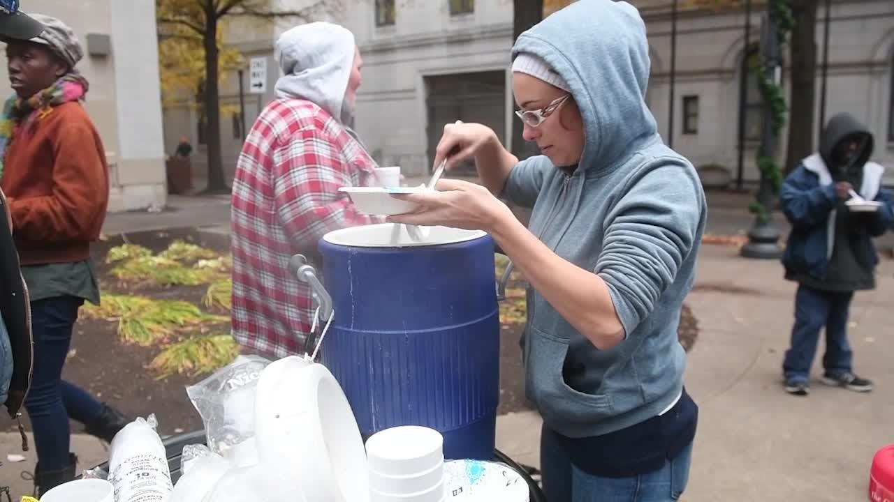 Classically trained French chef Eva Andres serves her grandmother's beef stew to hungry people at Krutch Park on Tuesday, November 27, 2018.