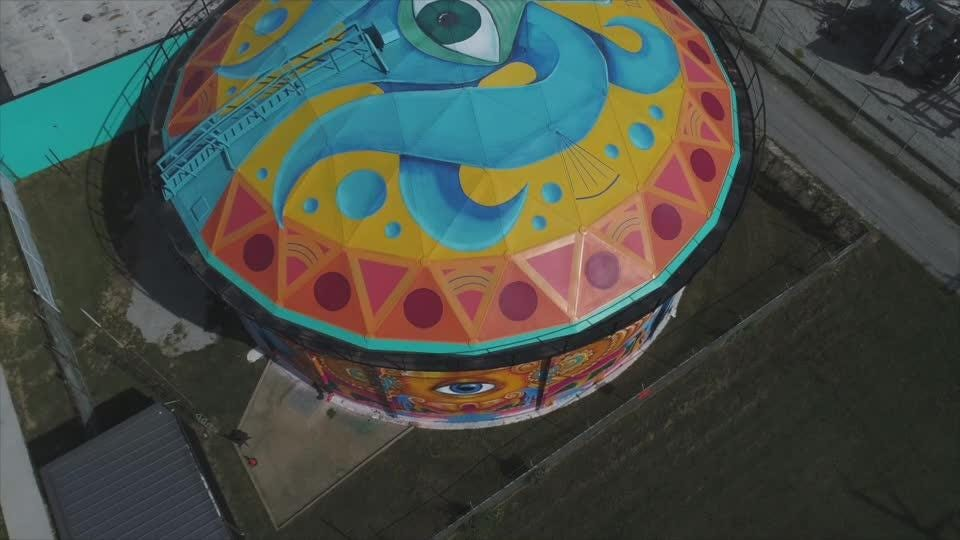 Go high above a very cool mural just across the river