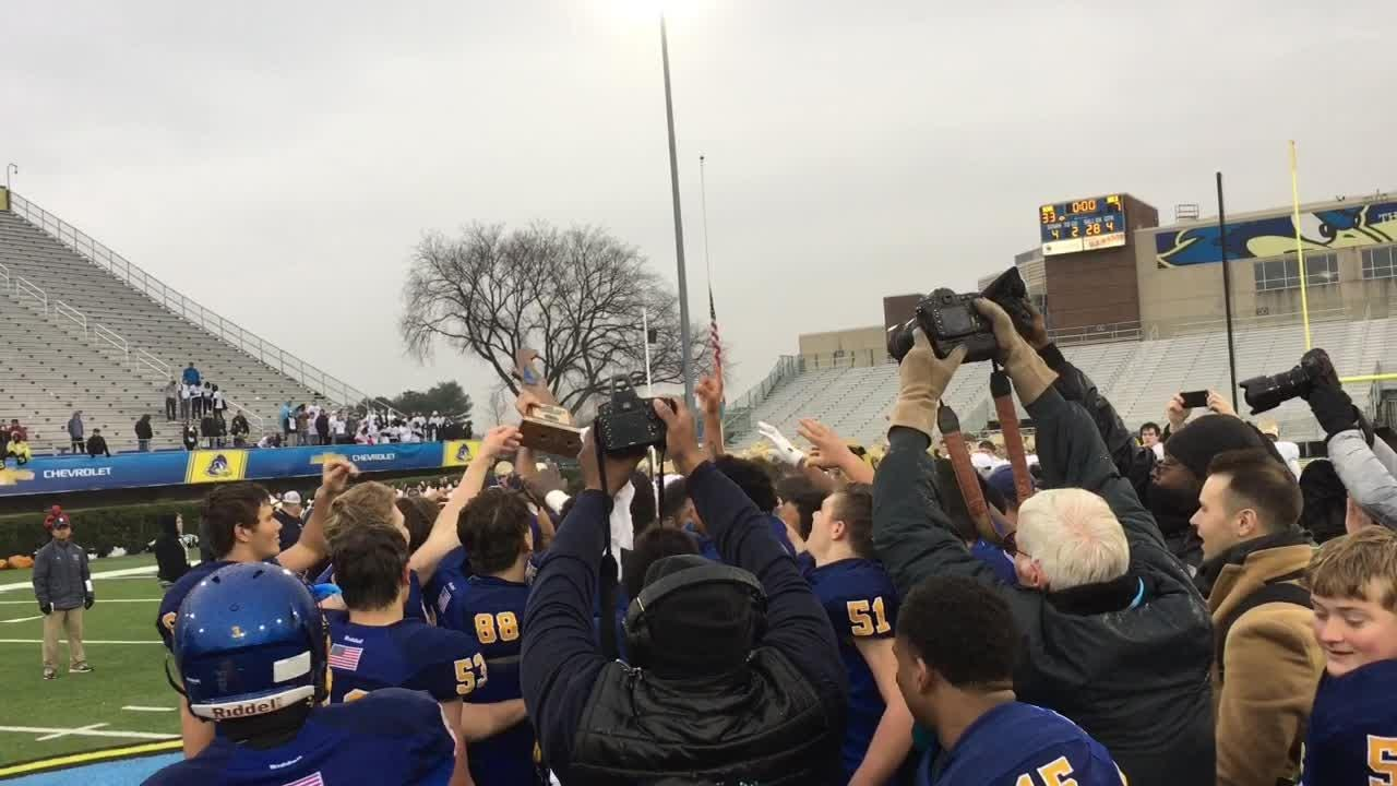 Sussex Central hoists first DIAA football championship trophy