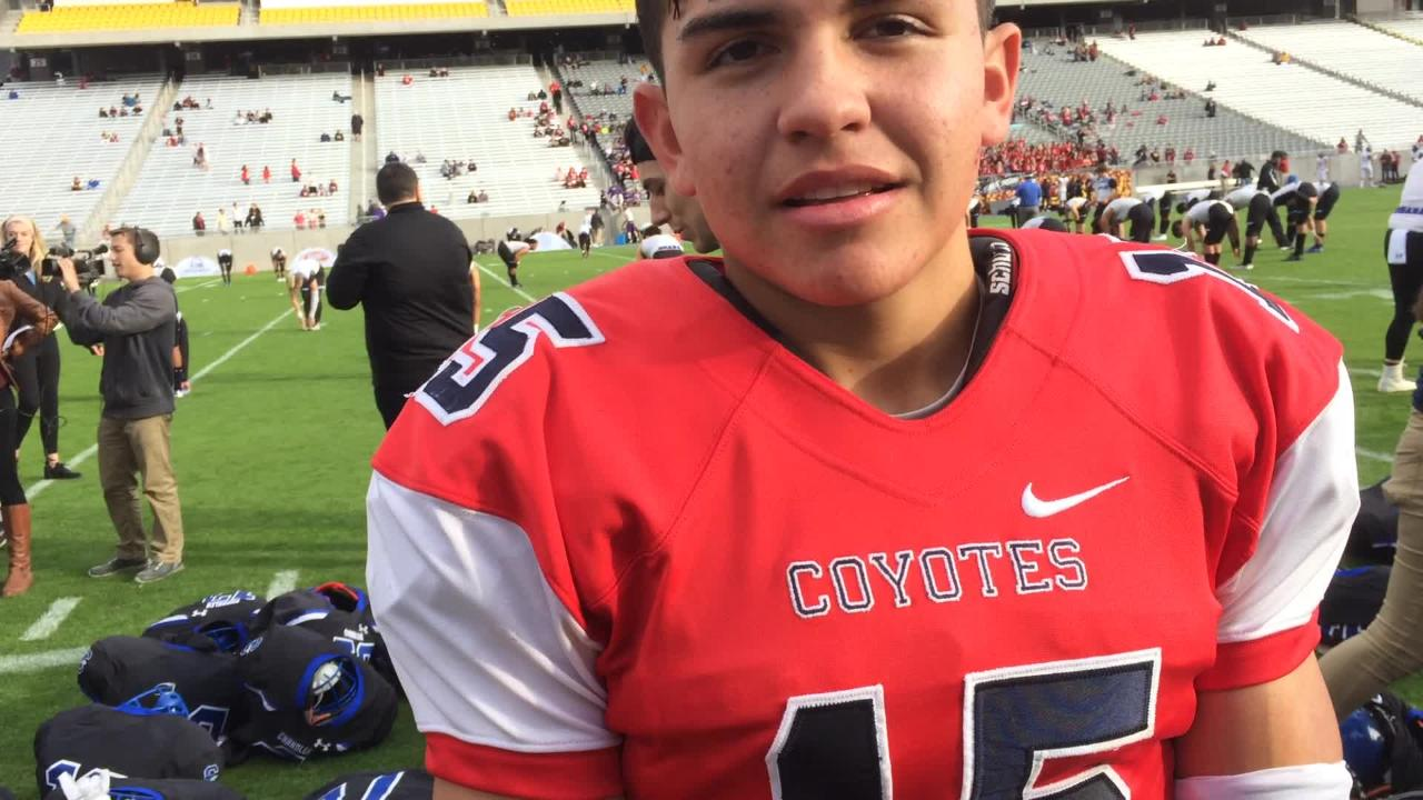 Centennial's Eric Haney after intercepting three Notre Dame passes in the team's 60-7 state championship victory.