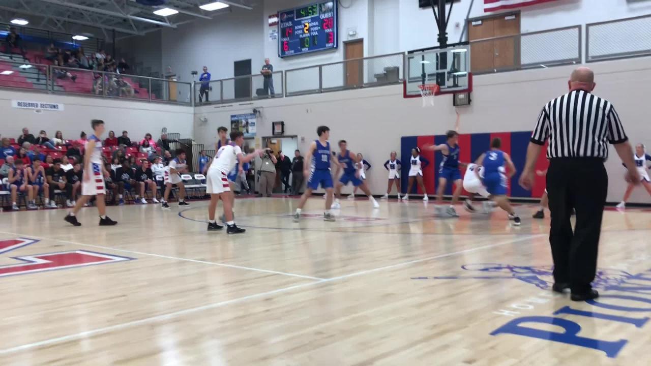 Zane Trace High School basketball's Triton Davidson sunk a shot after a nice spin move in his team's loss to Hilliard Davidson.