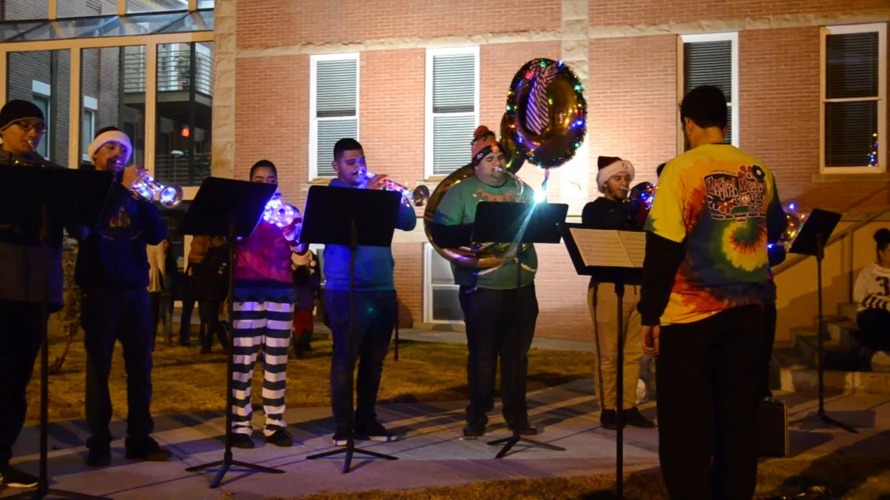 Deming High School band concludes the lighting of a Christmas Tree event