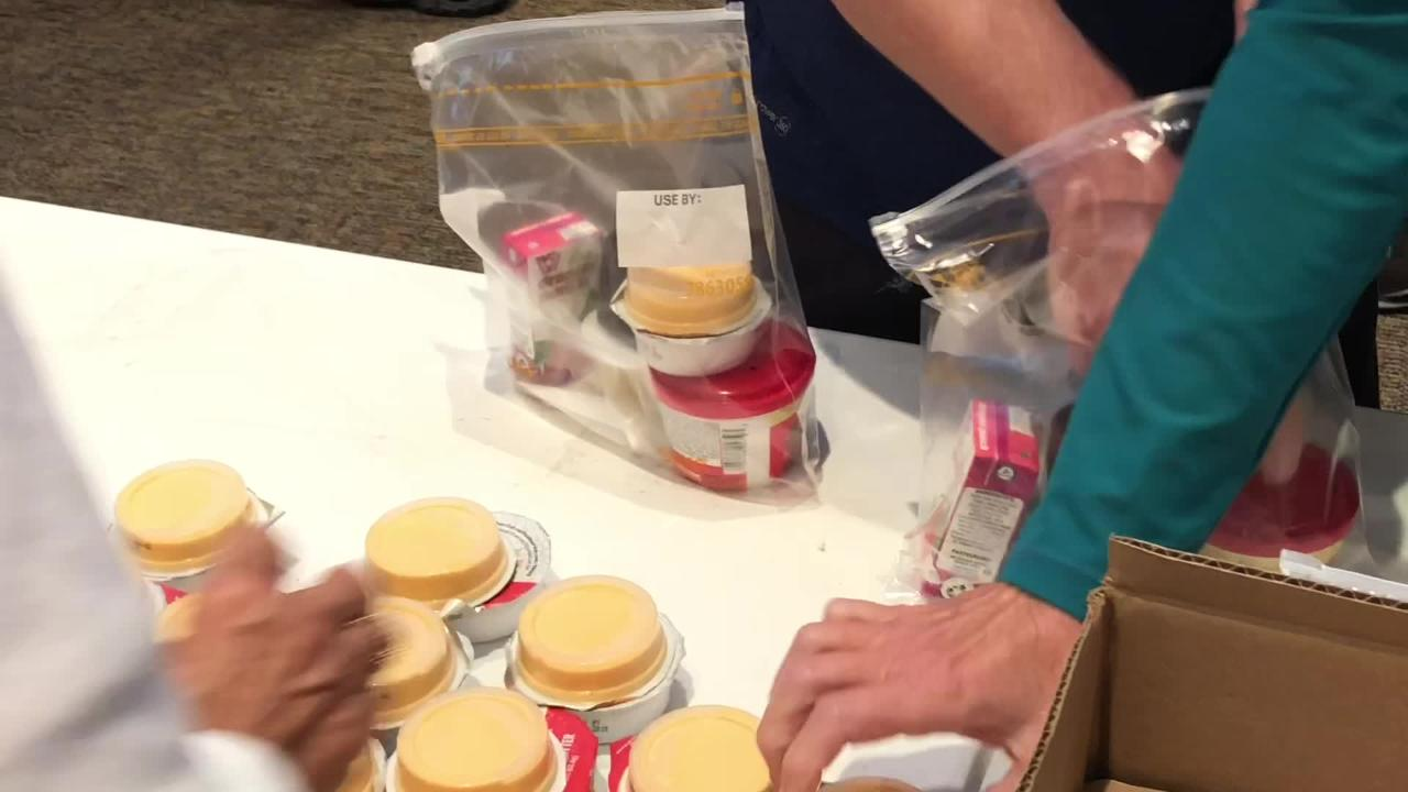 Volunteers from St. John the Evangelist Catholic Church gathered Saturday to create weekend meals for The Children's Hunger Project.