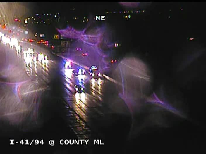 A tow truck driver and Wisconsin state trooper escaped serious injury Sunday night after a driver rear-ended a stopped cruiser along southbound I-94 in Kenosha County.