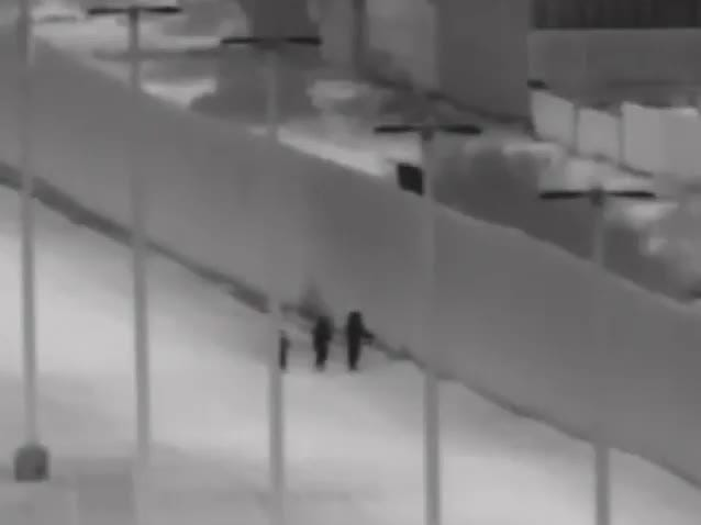 A Yuma Sector camera captures a family of six being assisted over the 18-foot border wall near San Louis Port of Entry early Monday morning.