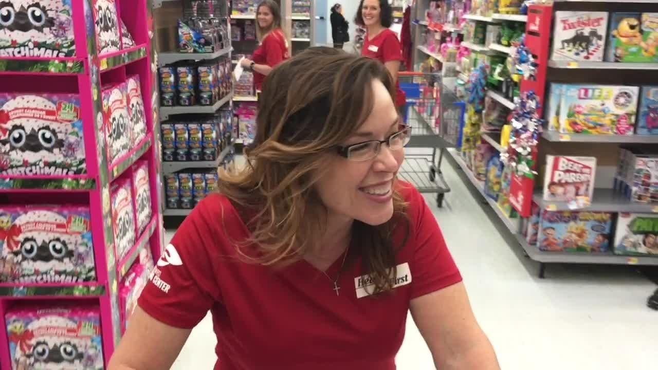Health First employees shopping for Christmas toys at the Viera Walmart to fill a truck for the South Brevard Sharing Center to send to needy kids.