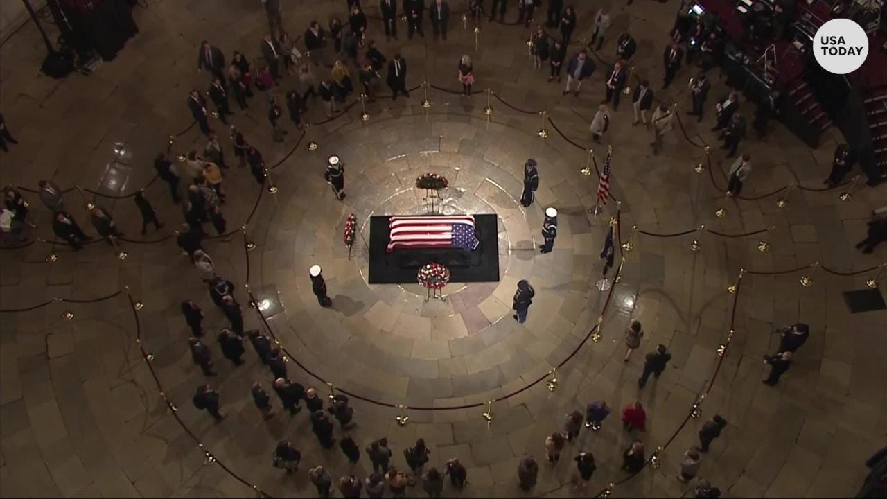 Visitors pay their respects to George H W  Bush at the U S  Capitol