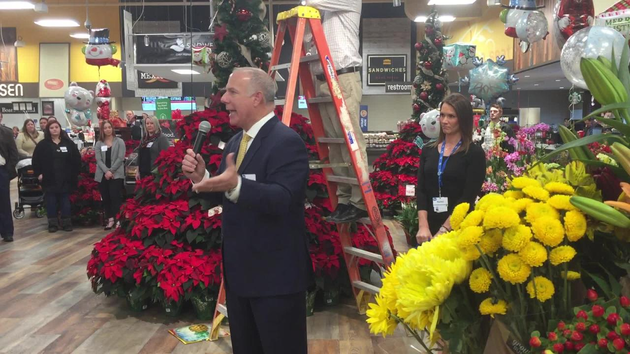 Kroger Co. of Michigan President Ken DeLuca addresses employees and customers at the recently expanded Brighton Kroger store before a ribbon cutting.