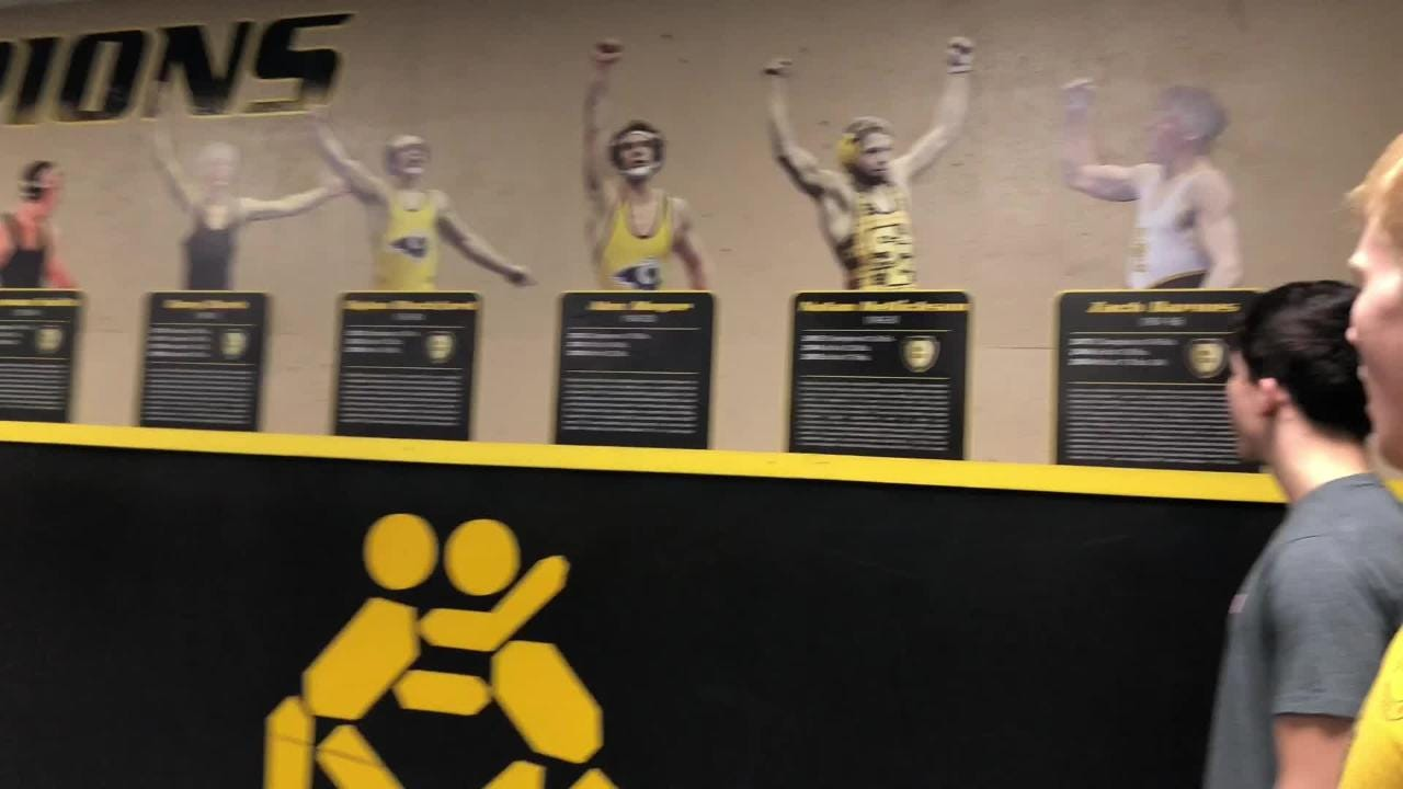 Junior Gabe Christenson and seniors Cade DeVos and Lance Runyon give a quick tour of the Southeast Polk wrestling room and showcase the successful history that's on the walls.