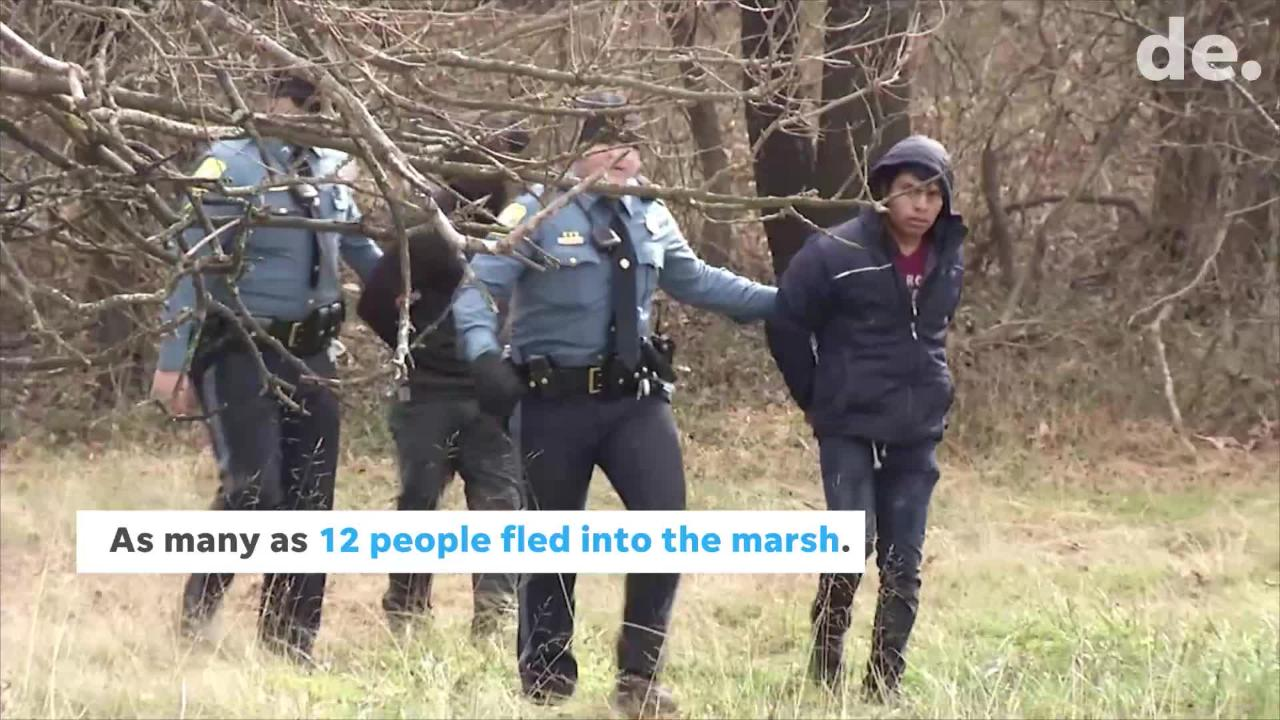 About a dozen people bailed out of an SUV onto an interstate near Newport when a police officer pulled them over. Many fled into the marsh.