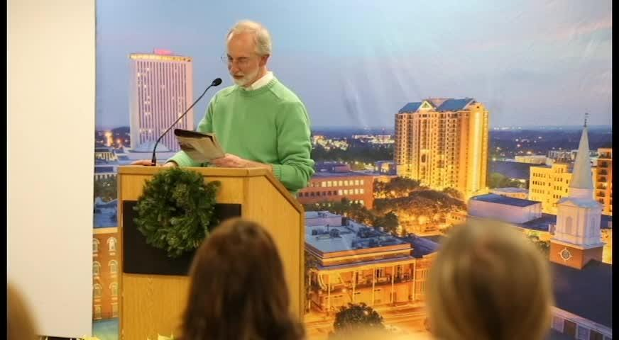 Ron Hartung, former Tallahassee Democrat staff member, reads an excerpt from Gerald Ensley's book, 'We Found Paradise'