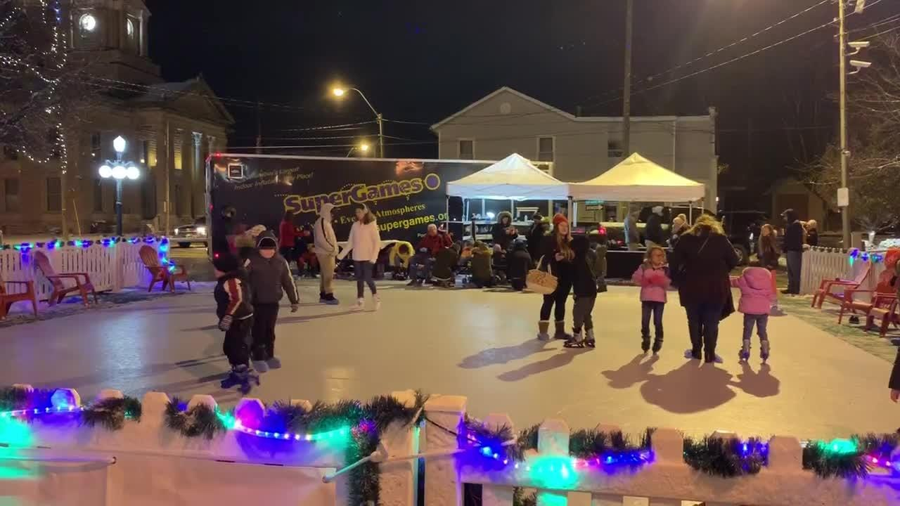 Community members skate on the synthetic ice rink at Bucyrus's Candlelight Christmas, Dec. 6, 2018.