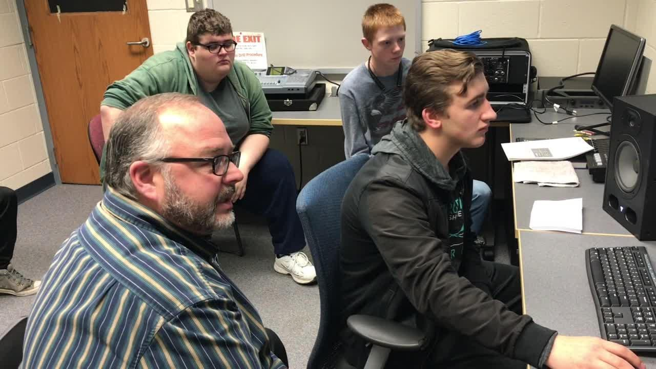 Duke Young mixes a jazz recording while instructor John Lindig explains the assignment during a sound engineering class at Ridgewood High School.