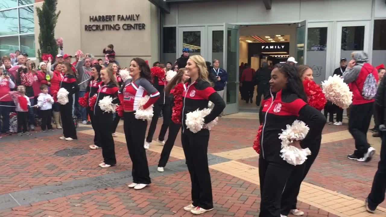 """The Luverne Tigers greet their fans at the pregame """"Tiger Walk"""" outside Jordan-Hare Stadium before the 2A championship game against Fyffe."""