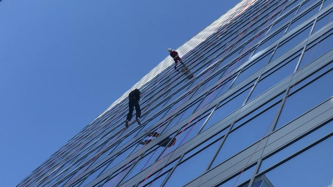 Hundreds rappelled down CityScape's 27-story high-rise building in Phoenix for a fundraising event for Special Olympics Arizona Saturday.