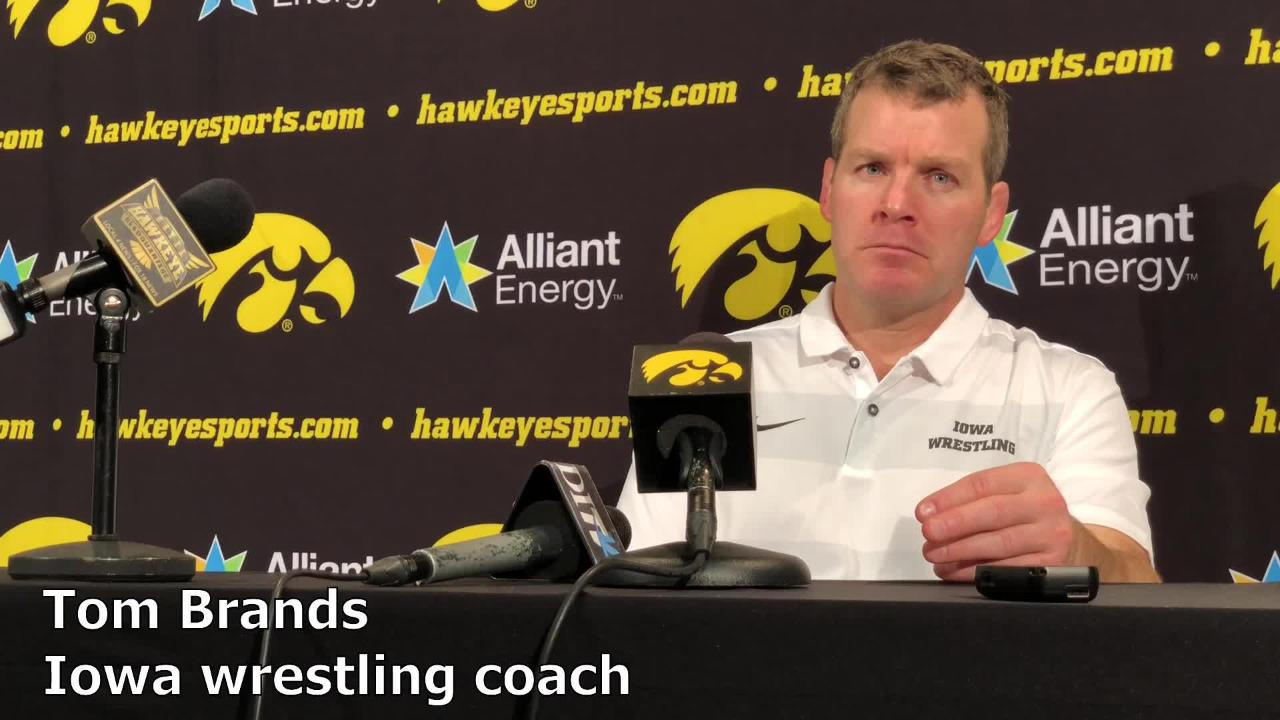 Iowa wrestling Tom Brands reacts after the Hawkeyes' 28-14 win over Lehigh on Saturday night in Iowa City.