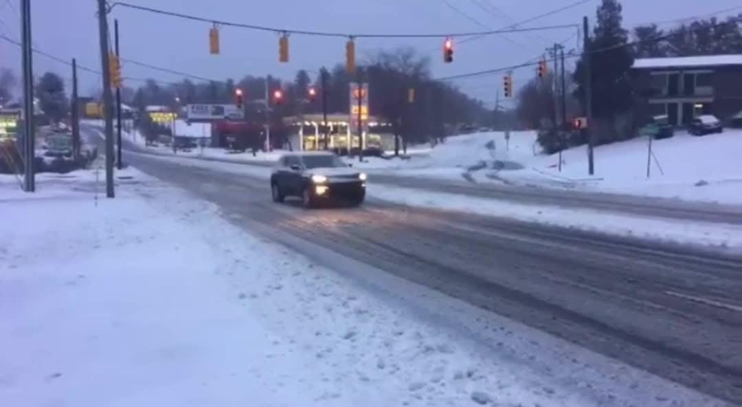 A video shared to Twitter from the City of Asheville shows road conditions on Tunnel Road at 8 a.m. Sunday morning after a snowy night.