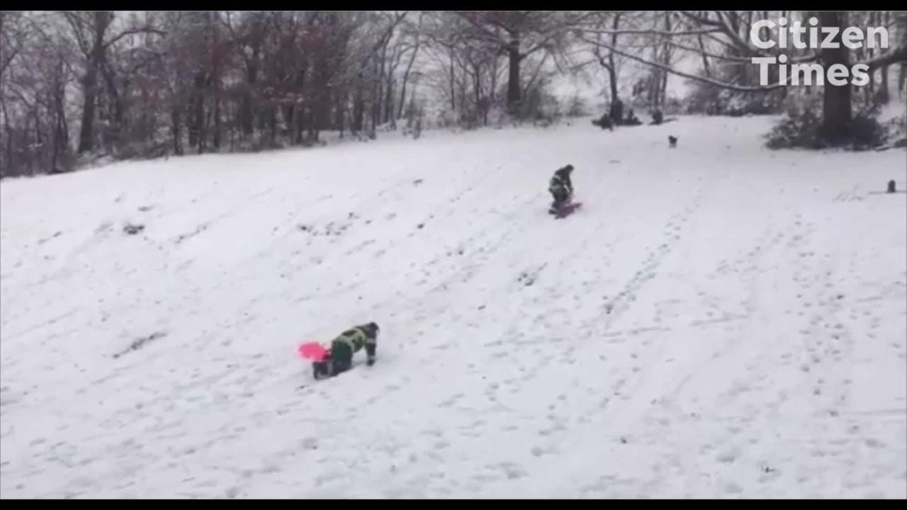 Asheville firefighters go sledding after weekend snow storm in WNC on Sunday, Dec. 9, 2018.